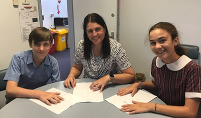 Mrs Creagh the principal working with two Year 6 leaders.